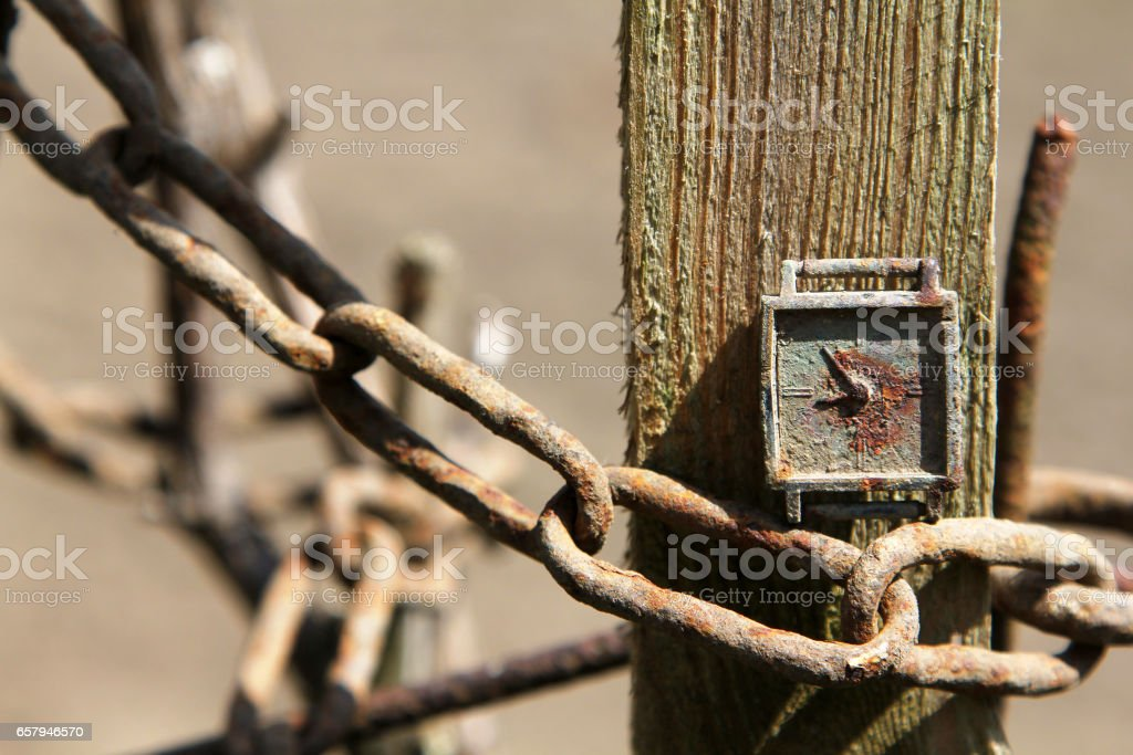 Old rusty clock on a chain stock photo
