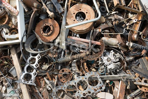 Old rusty corroded car parts in car scrapyard. Car recycling.Wrecking Machinery Parts wait for reused or to be a part for repair.
