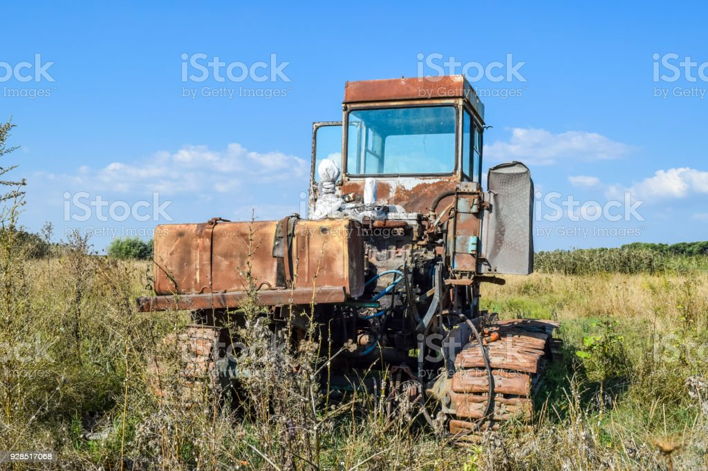 Old rusty disassembled combine harvester. stock photo