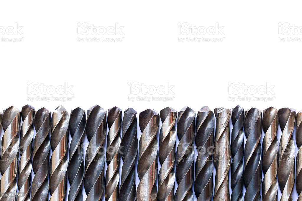 old rusty drill bits isolated on white background stock photo