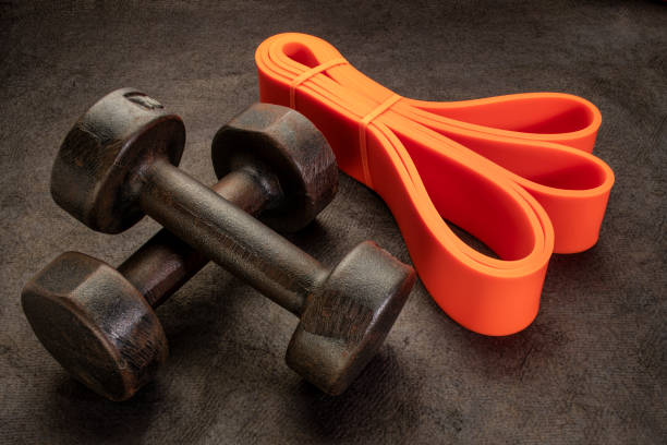 old rusty dumbbells and resistance bands stock photo