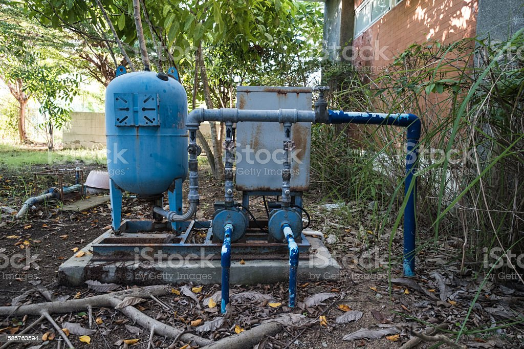 Old rusty electronic water pump in the forest stock photo