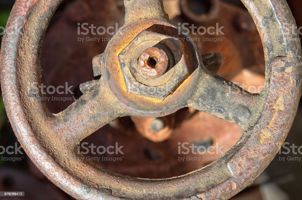 Old rusty faucet crane. Round handle of water supply valve close-up stock photo