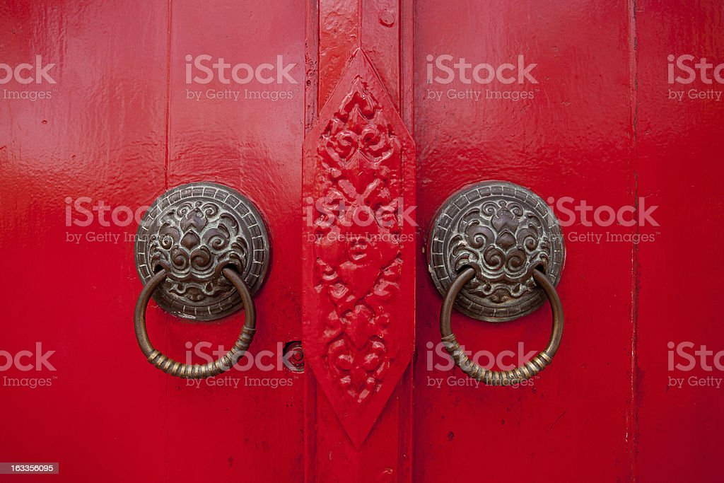 Old rusty gate latch on the red door. royalty-free stock photo