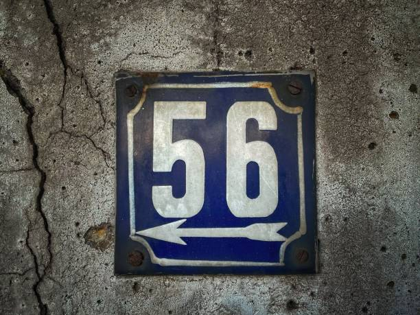 Old rusty house number plate, old house number, street number, number 56 stock photo