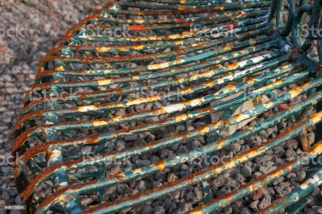 Old rusty iron benches stock photo