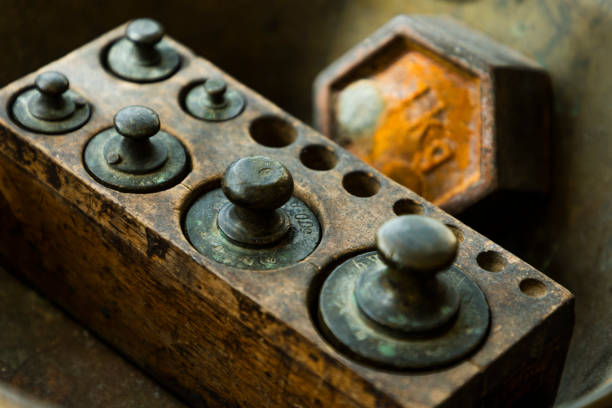 Old rusty iron scale weight. stock photo