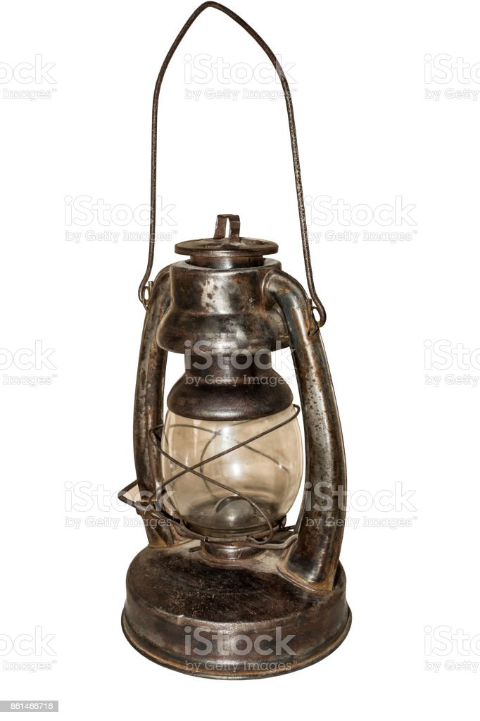 old rusty kerosene lamp on a white background stock photo