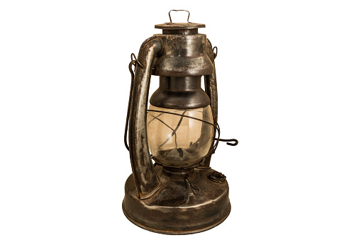 old rusty kerosene lamp on a white background