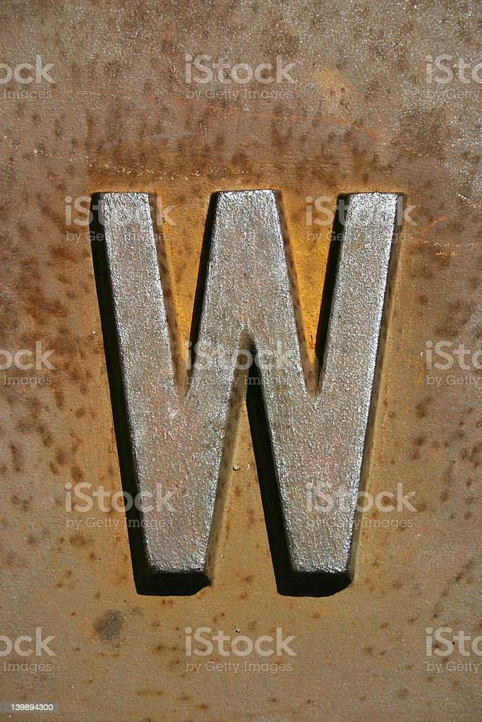 old rusty letter w stock photo