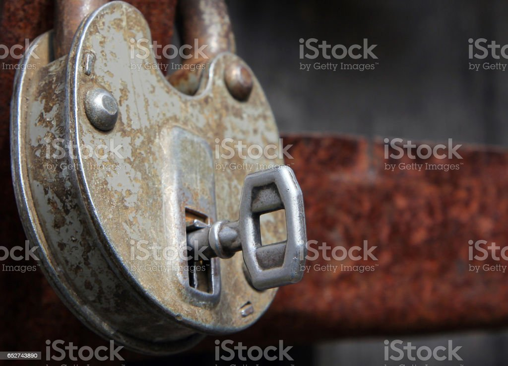 Old rusty lock with key stock photo