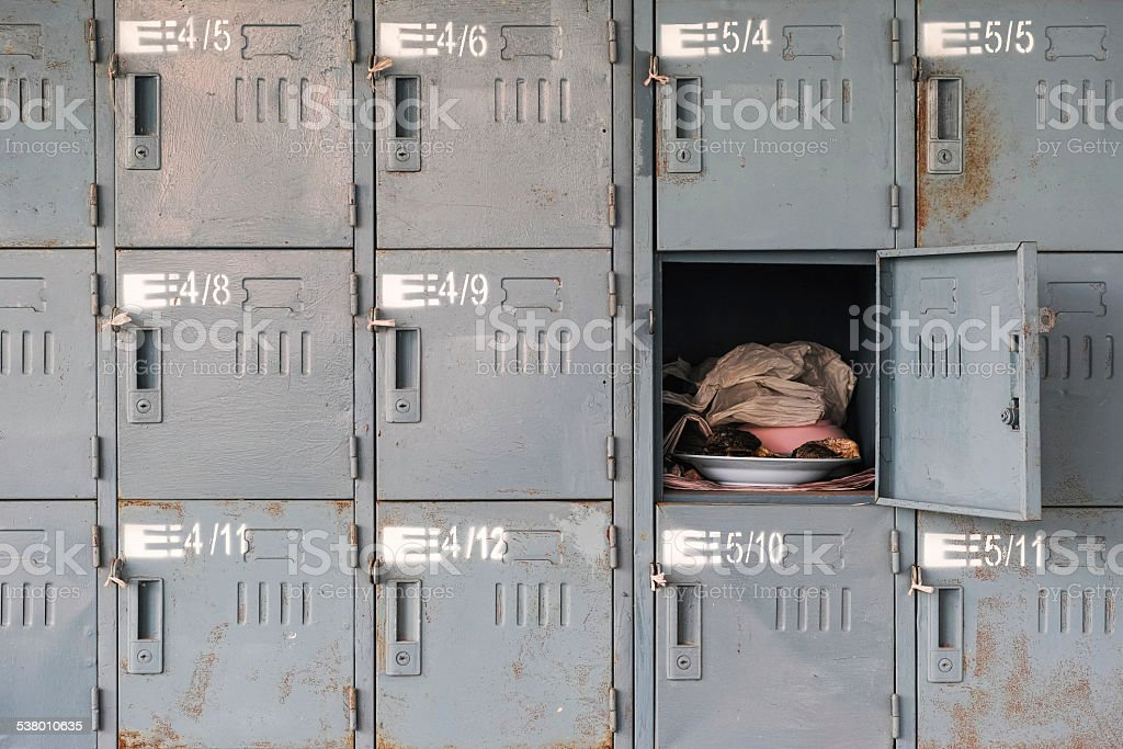 Old rusty lockers with one opened stock photo