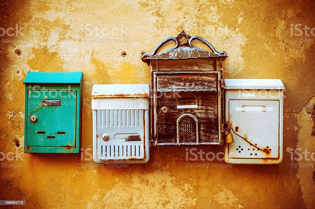 Old rusty mailboxes stock photo