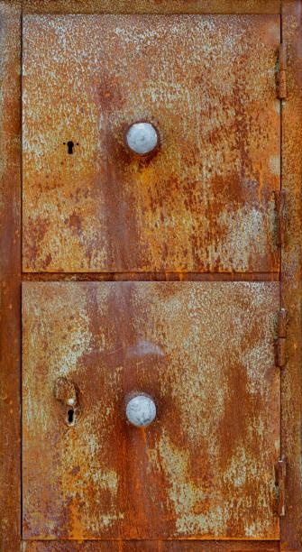Old rusty metal cabinet doors stock photo