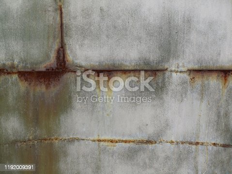 636061068 istock photo Old rusty metal wall surface background for your design. 1192009391
