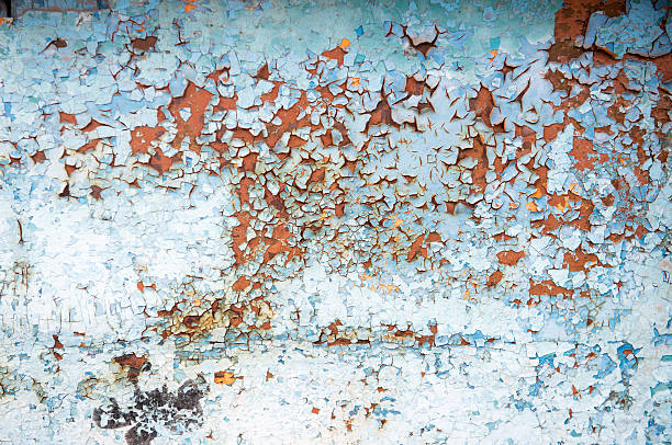 Old rusty metal wall with blue peeling paint stock photo