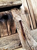 istock Old rusty nail into a wooden fence 1045106186