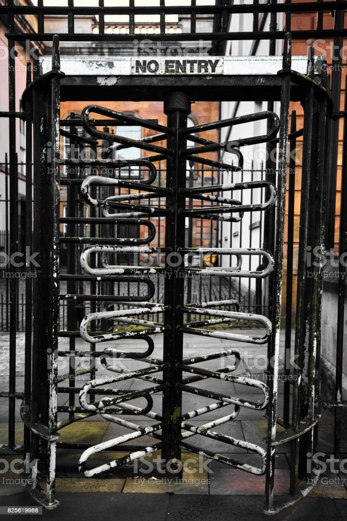 Old rusty No Entry turnstile in a street in Derry Northern Ireland stock photo