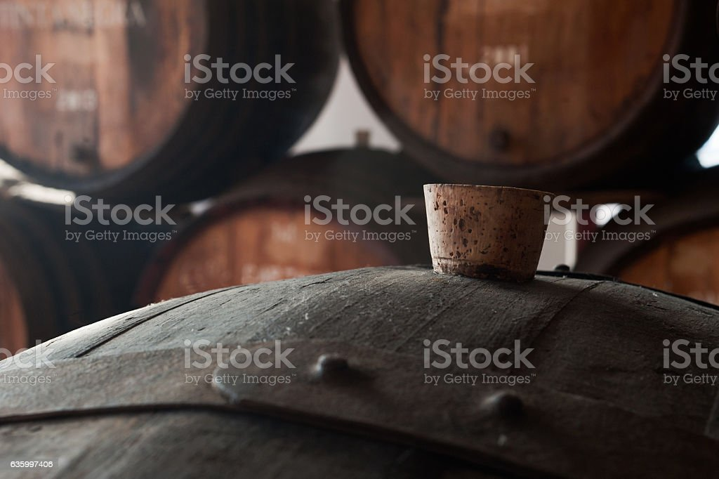 Old rusty oak barrels with cork bung. stock photo
