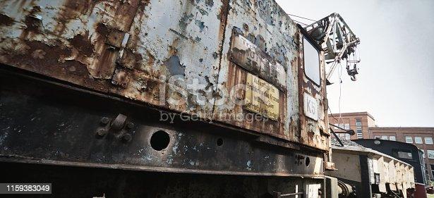 Old rusty railway crane on the siding, German translation: Don't move under the crane!