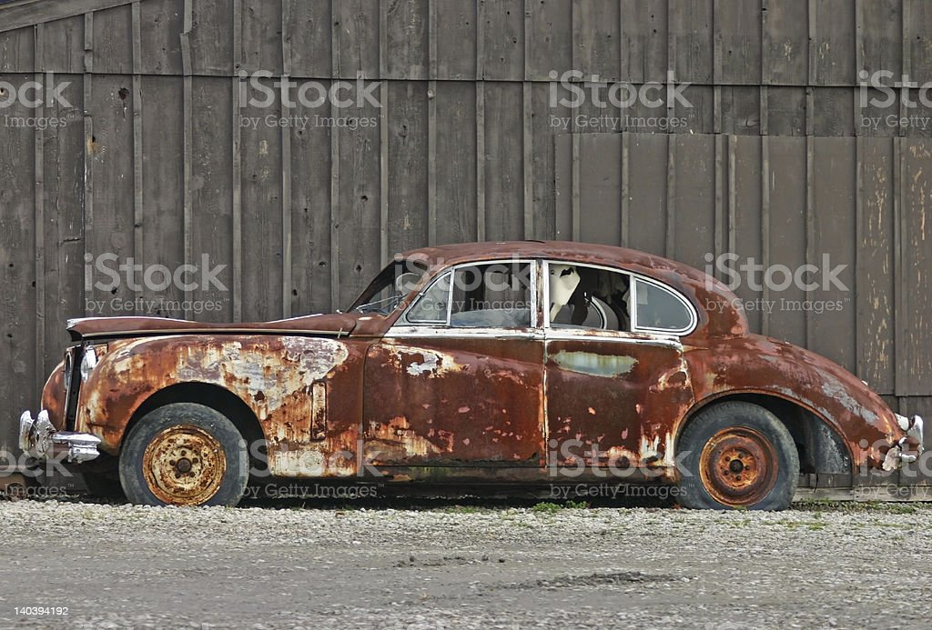 Old Rusty Rolls Royce stock photo