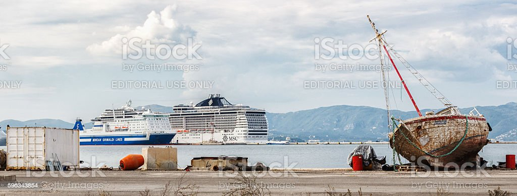 Old rusty sailing boat and two big modern ocean liners. royalty-free stock photo