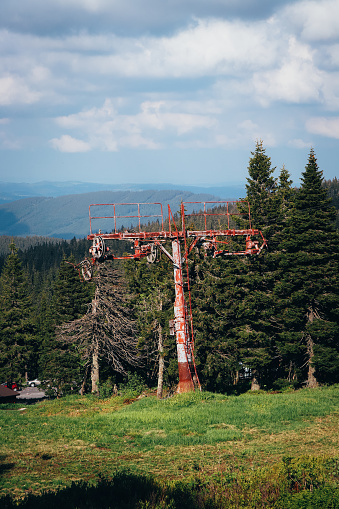 istock Old rusty ski lift standing on the top of Vysoka hole in Hruby Jesenik, in the Czech mountains on the border with Poland. Abandoned ski transport facility. Nature reserves in the Czech Republic 1263782293