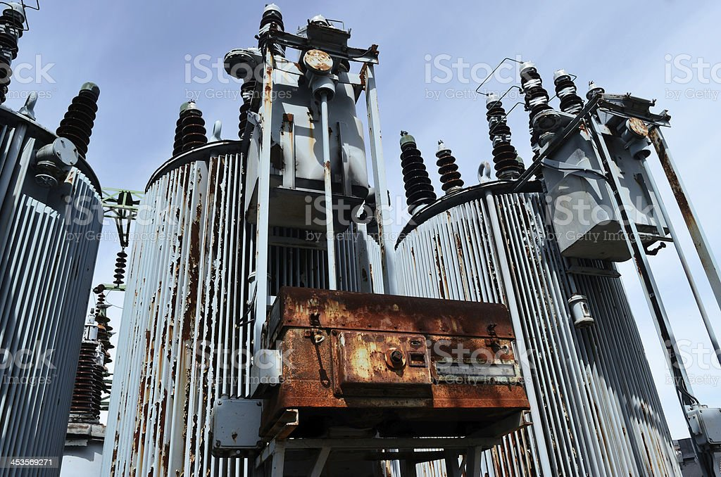 old rusty transformer substation against the blue sky royalty-free stock photo