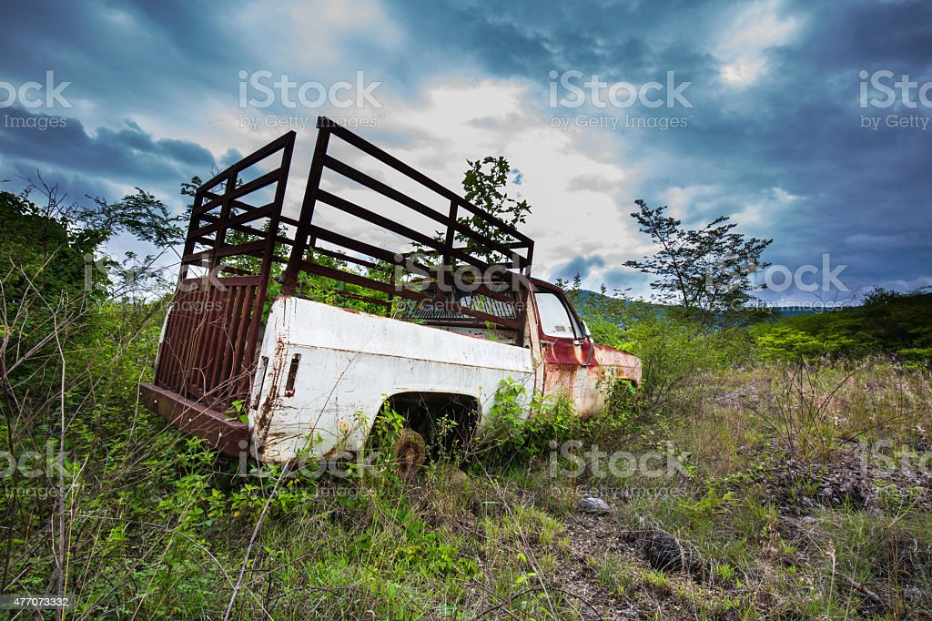 Old Rusty Truck against a stormy sky. stock photo