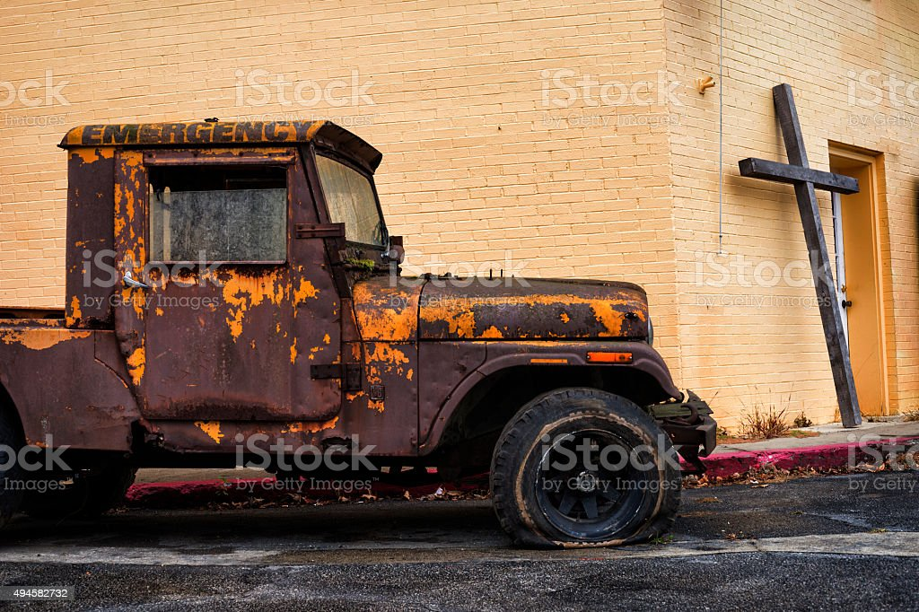 Old rusty truck and wooden cross stock photo
