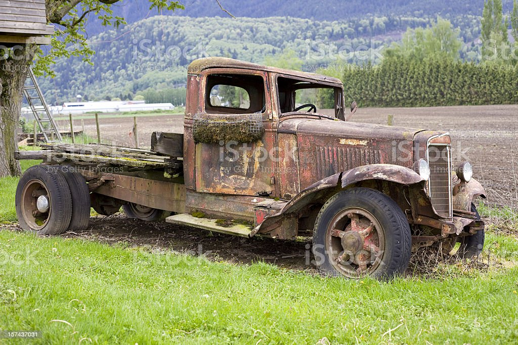Old Rusty Truck on a field royalty-free stock photo
