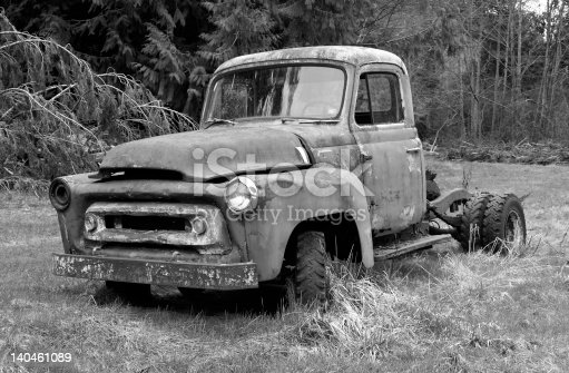 Old rusty truck in a country field.