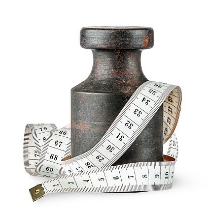 istock Old rusty weight wrapped centimeter 641382714