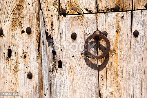 1178501072istockphoto Old Rusty Wooden Doors (2) 518379309
