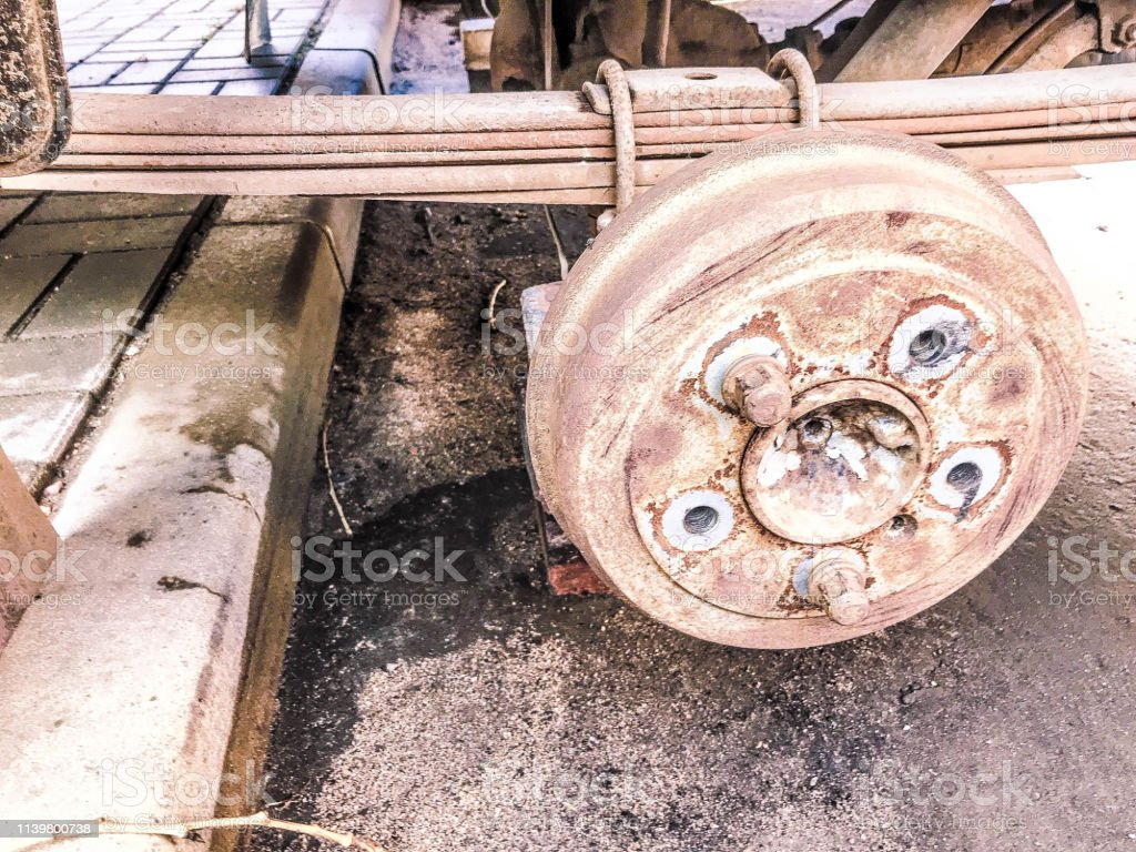 Old rusty worn drum brakes of a truck, car. Automotive suspension...