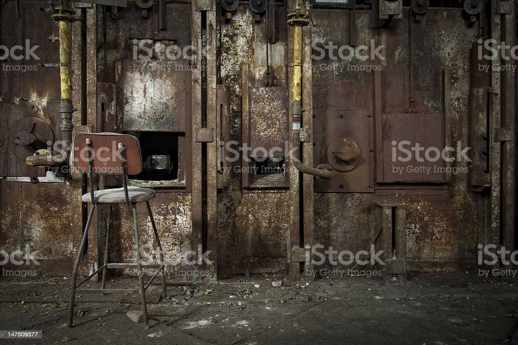 Old rusty zinc smelter furnace in abandoned industrial factory. stock photo