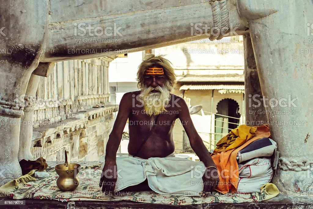 Old sadhu sitting in the lotus position in Jagdish temple in Udaipur stock photo