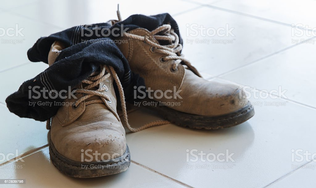 Old safety shoes with sock for safety foot.