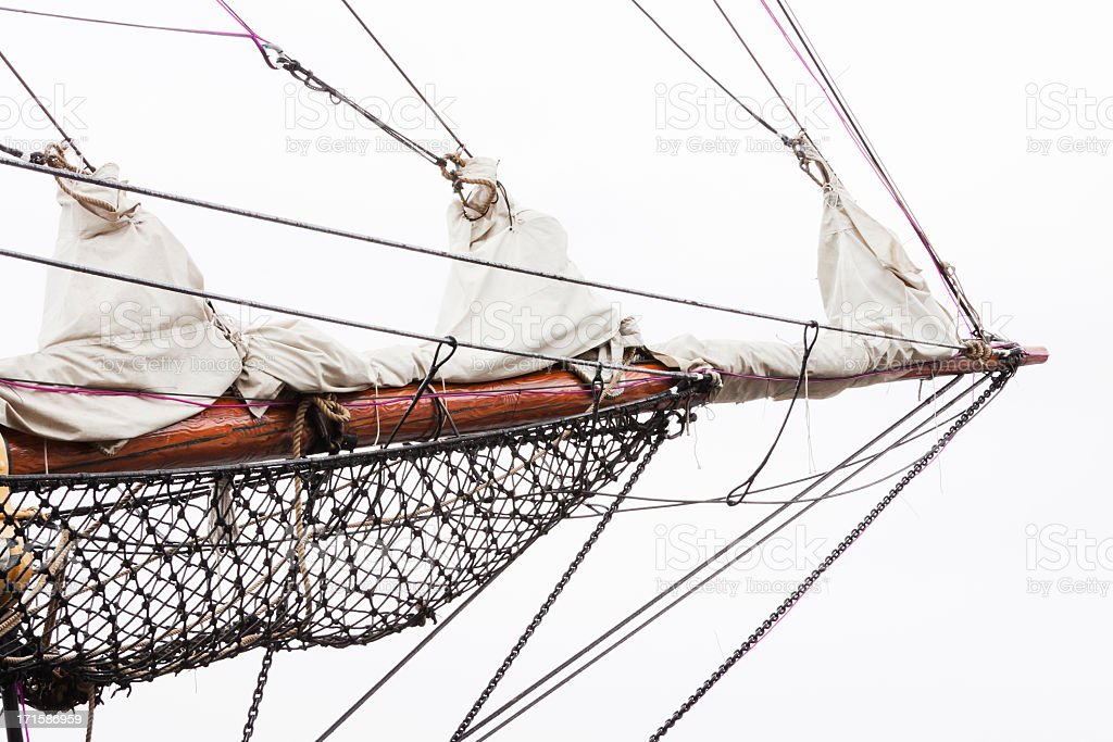 Old sailing ship bowsprit against white background, copy space stock photo