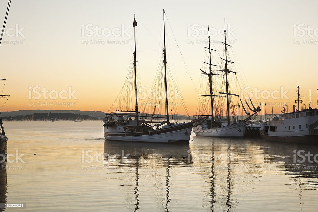 Old sailing ships  at sunset. royalty-free stock photo