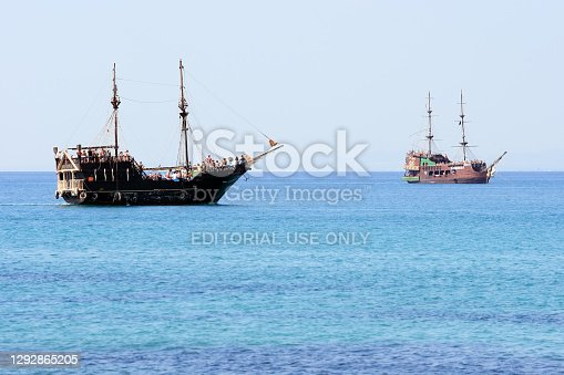 Hammamet, Tunisia - August 15, 2007: Tourists ride on old sailing ships near Hammamet in Tunisia