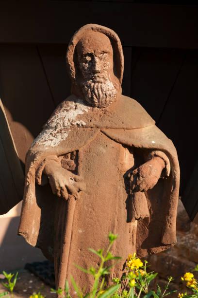 Old saint statue stock photo