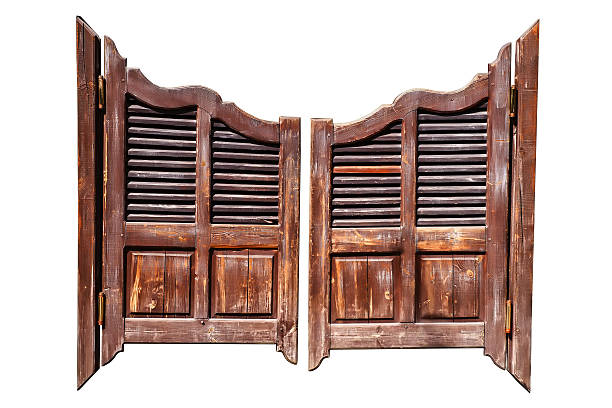 Old saloon doors isolated Old rough wooden saloon doors isolated on white with clipping path saloon stock pictures, royalty-free photos & images