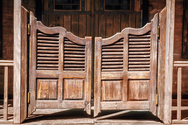 old saloon entrance - western town stock photos and pictures