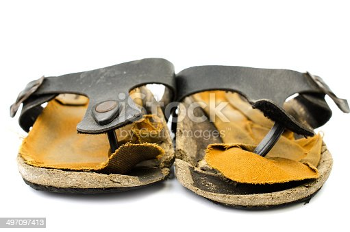 959792752 istock photo Old Sandals over white 497097413