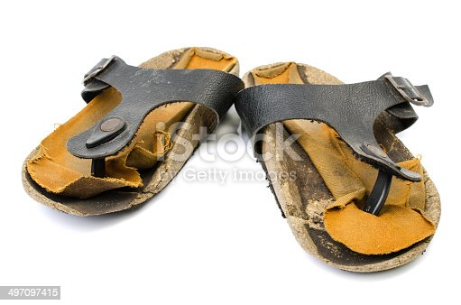 959792752 istock photo Old Sandals over white 497097415