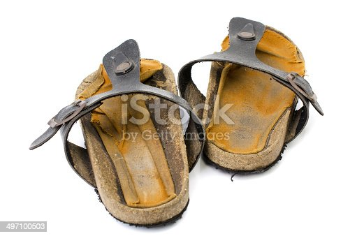 istock Old Sandals over white 497100503