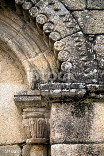 Old Santiago romanesque church ( XII century) arches, column, capitel  in Allariz village, Ourense province, Galicia, Spain.