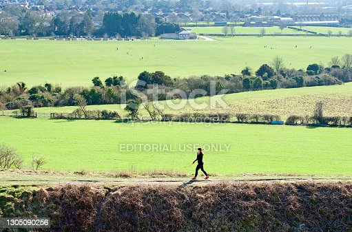 istock Old Sarum hill fort public park with recreational visitors, Salisbury, Wiltshire, England 1305090256