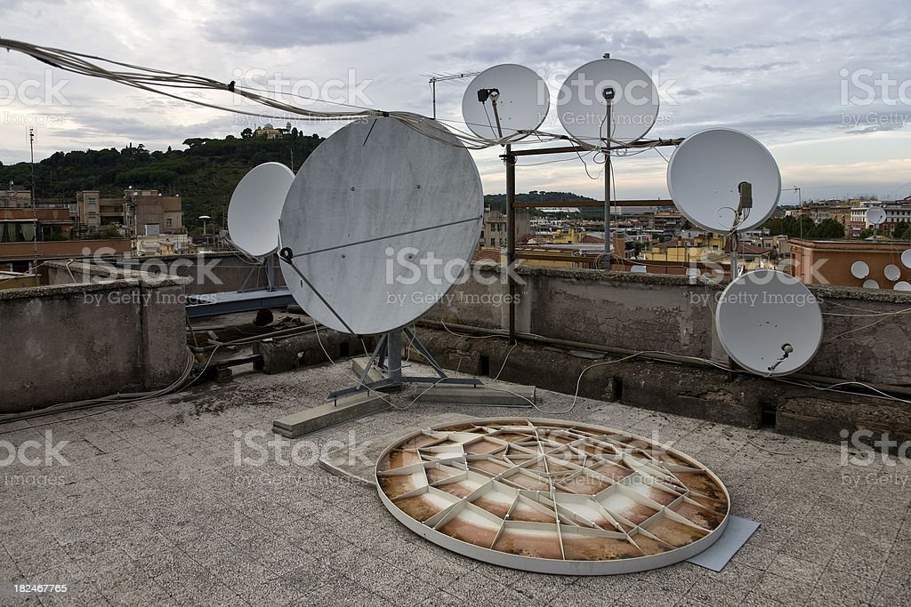 old satelite dishes stock photo